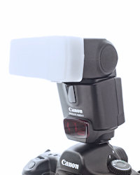 on-camera flash fitted with a diffuser